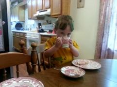 Littlest enjoying his tea