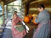 Homeplace ladies carving pumpkins