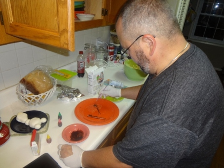my husband painting the snowman arms