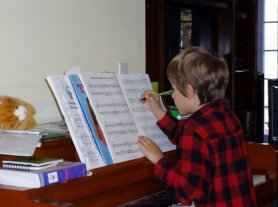 Middle Boy trying his hand at composing