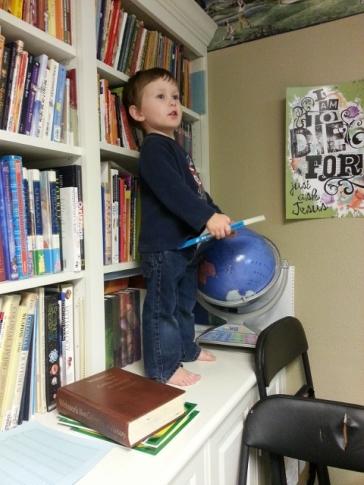 Littlest raiding the book shelf