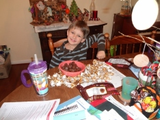 Middle Boy unwrapping all of the candy for Christmas goodies