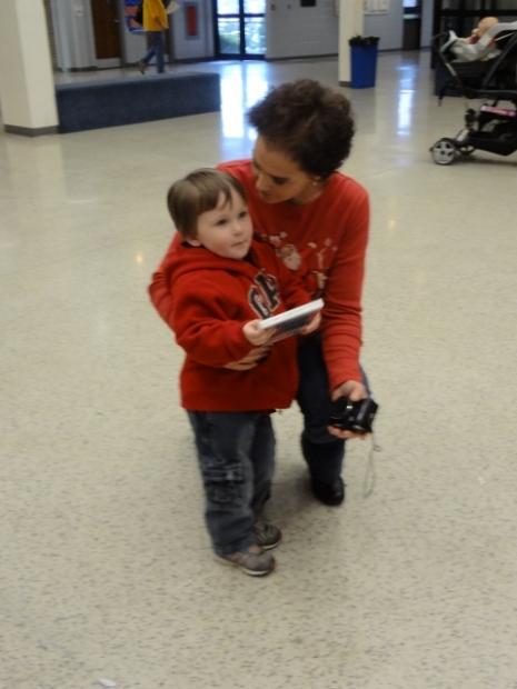 Littlest with preschool teacher