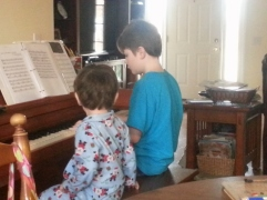 Oldest and Littlest at the piano