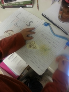 Middle Boy working in science journal