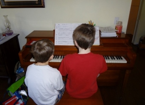 Oldest working with Middle Boy at the piano
