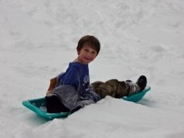 Middle Boy sledding