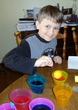Middle Boy dying eggs