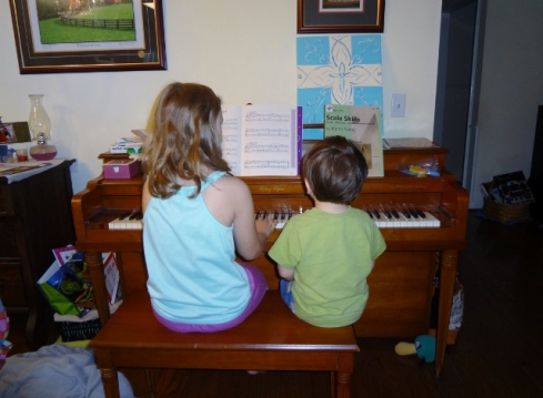 Sparkles and Littlest at piano