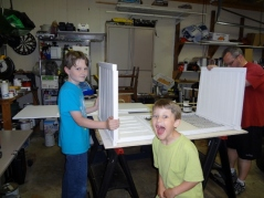 working on outdoor bunny cage...with Middle Boy photo bomb!