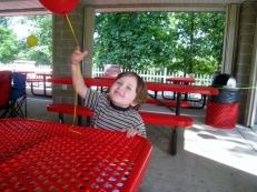Littlest playing with baloon
