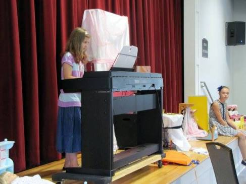 Sparkles playing piano at camp