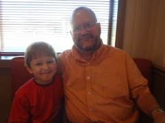 my husband and Middle Boy at Hutchen's BBQ