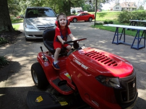 Littlest pretending to mow