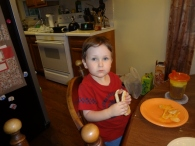 Littlest eating his first hot dog in the bun...I've always has to cut them up in the past
