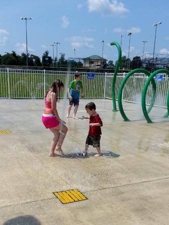 playing at the splash pad