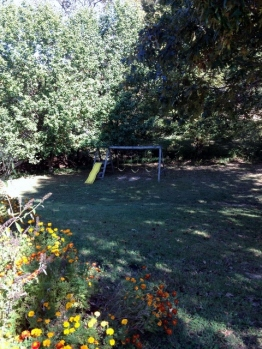 Text from my husband at our former home. The lonely and quiet swing-set