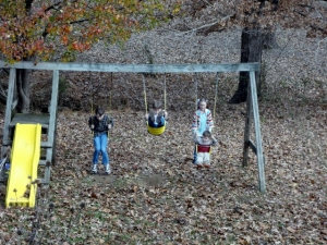 playing on the swingset at the old house