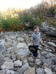 Littlest at the river with his Indiana Jones hat