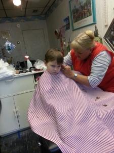 Littlest hates getting his hair cut