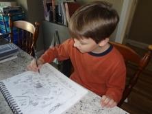 Middle Boy enjoying art lessons