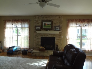 curtains and decorated mantel