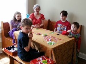Mom and kids playing Apples to Apples
