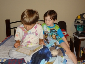 Middle Boy reading a bedtime story to Littlest