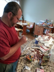 mu husband designing the birthday cupcakes