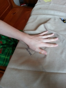 checking handprint on the Thanksgiving cloth