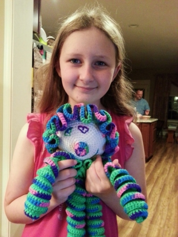 Sparkles with her crochet clown...I like the heart eyes