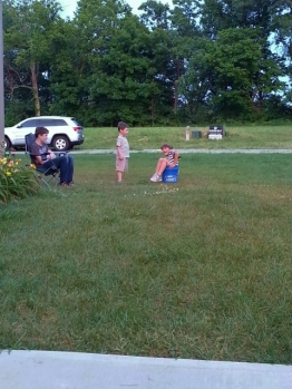 Middle Boy got stuck in the bucket and all I did was take his picture!!! So much for Mom of the Year awards...
