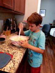 Middle boy making dinner
