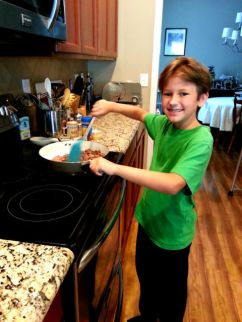 Middle Boy cooking dinner