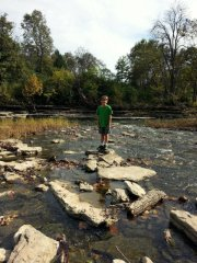 Middle Boy looking for nature treasures