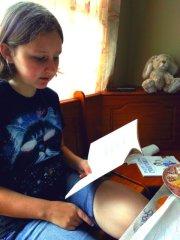 Sparkles reading a poem