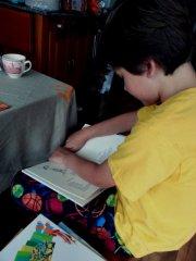 Middle Boy reading a poem