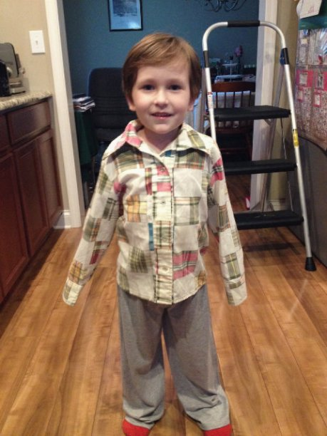 Littlest modeling a shirt my husband's mother made for my husband when he was the same age!!! Still soft and comfy!!!