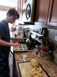 teaching Oldest to make rolls