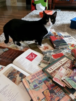 Boots investigating the books