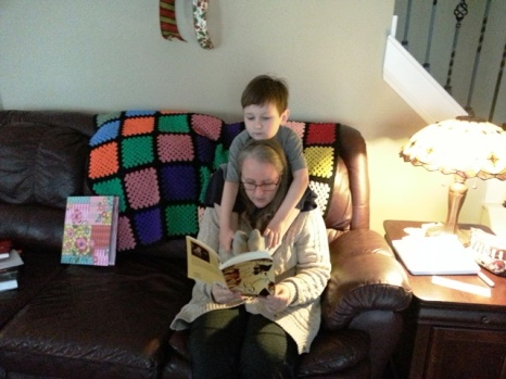 this is what read-aloud time looks like with Littlest...no wonder my back hurts
