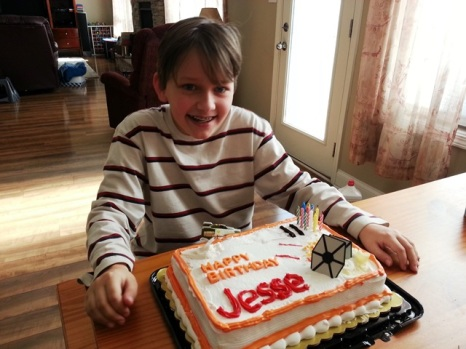 birthday boy and his Star Wars cake