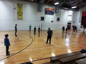 learning to play volley ball with their Adventure School group