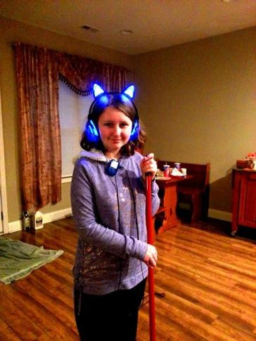 Sparkles sweeping with her light-up kitty headphones