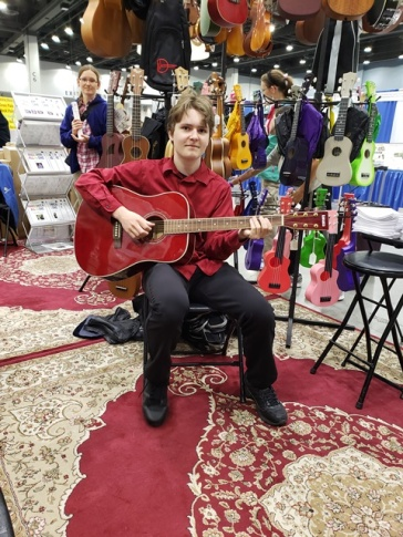 he played every guitar he found at the convention